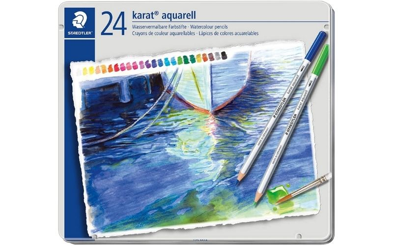 a watercolor painting atop a set of watercolor pencils