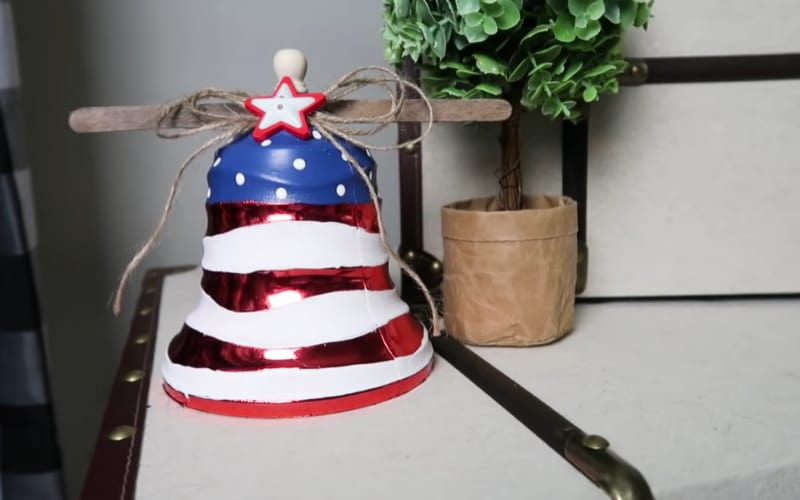 an image of a craft liberty bell made from a Christmas bell