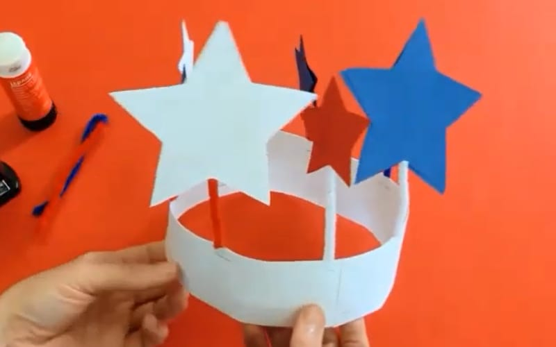 an image of a crown made with construction paper and adorned with stars
