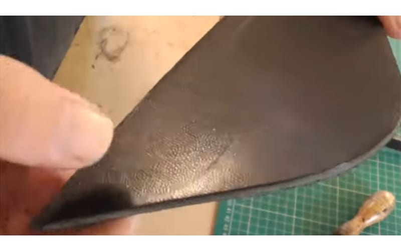 an image of a scrap of leather showing a slight mark on it