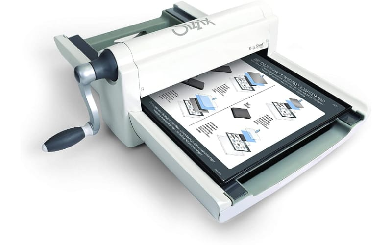 an image of the Sizzix Big Shot Plus die-cutting and embossing machine in white and gray construction