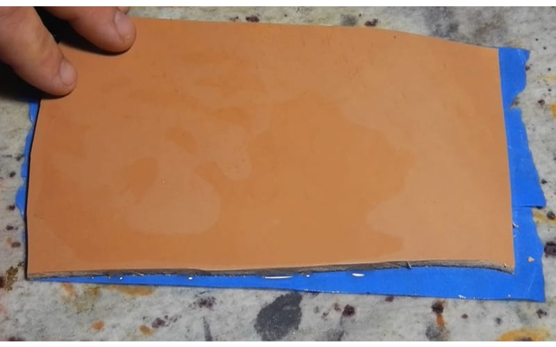 an image showing a piece of leather wet with water