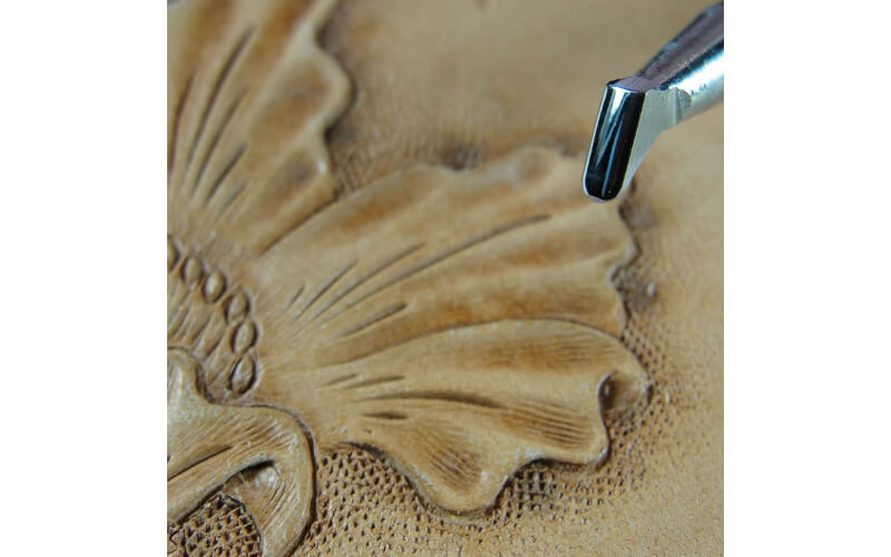 an undercut beveler stamp showing the undercut design it gives to embossed flowers on leather