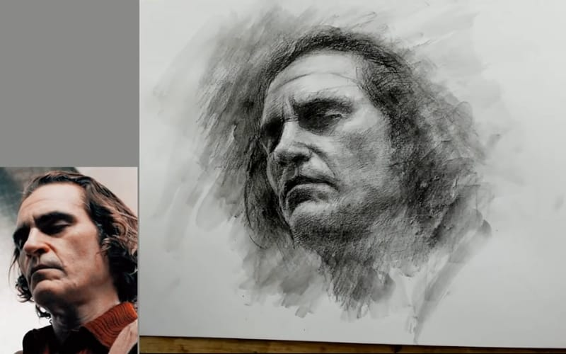 Charcoal portrait of Joaquin Phoenix beside a reference photo - Image by CZ Art