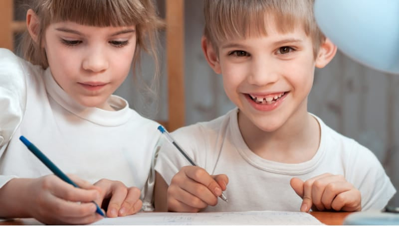 Kids drawing with ink pens