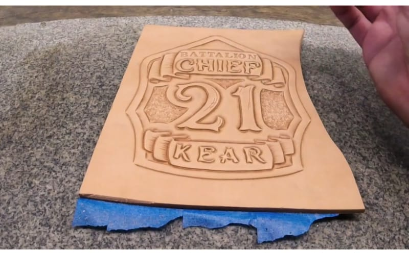 an embossed badge on a piece of leather