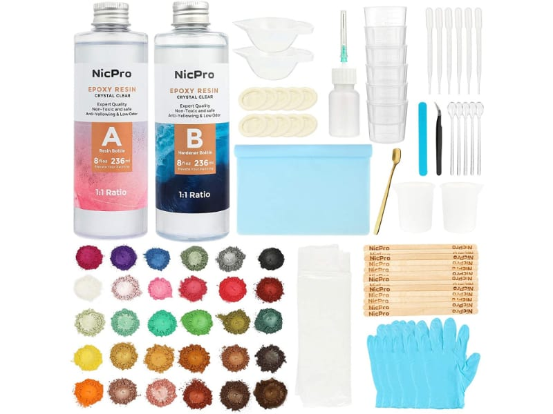Clear Epoxy Resin Starter Kit with measuring cup, silicone mat, mica powder, and supplies