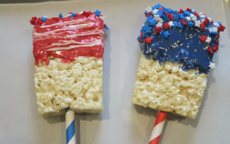 Rice Krispies dipped in colorful chocolate and littered with star sprinkles