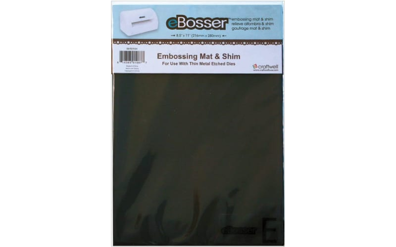 rubber embossing mat and magnetic shim in its original packaging