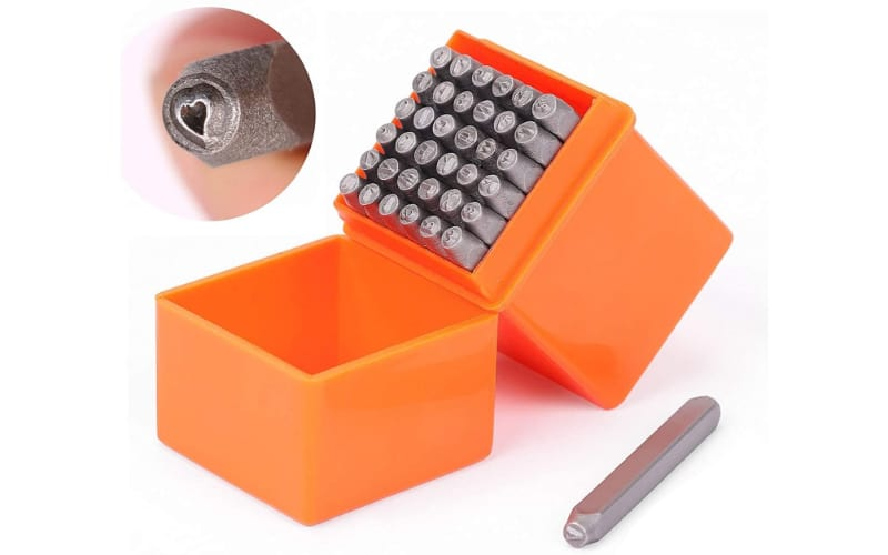 set of letter stamps in a bright orange plastic box