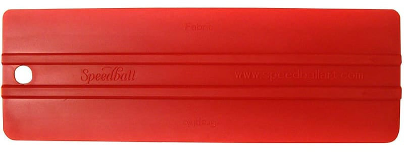 a red double-edged plastic squeegee