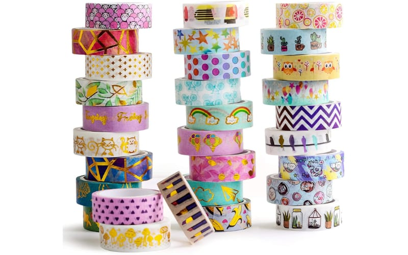 stacks of washi tape in different colors and designs