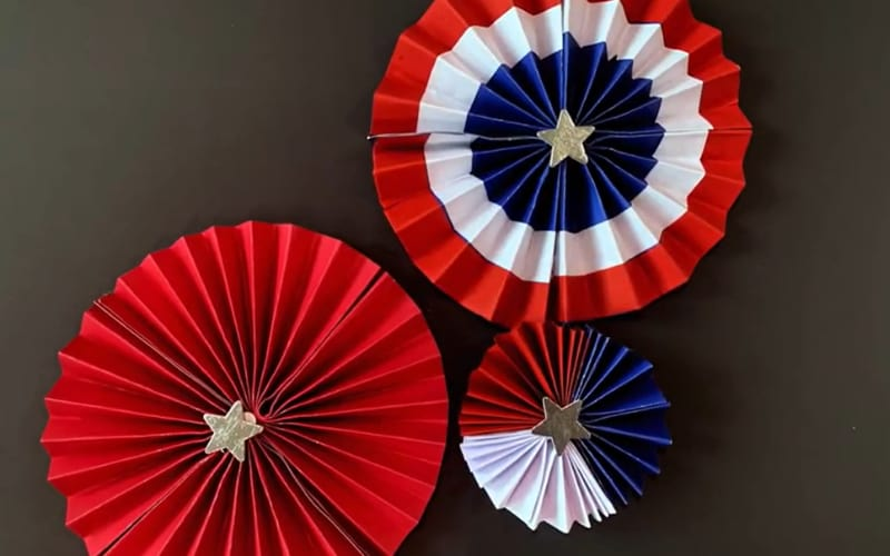 three accordion fold decors made from red, white, and blue cardstock