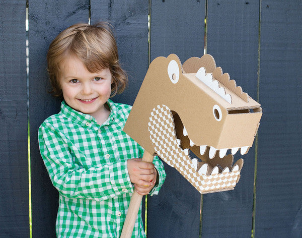 dinosaur toy in cardboard