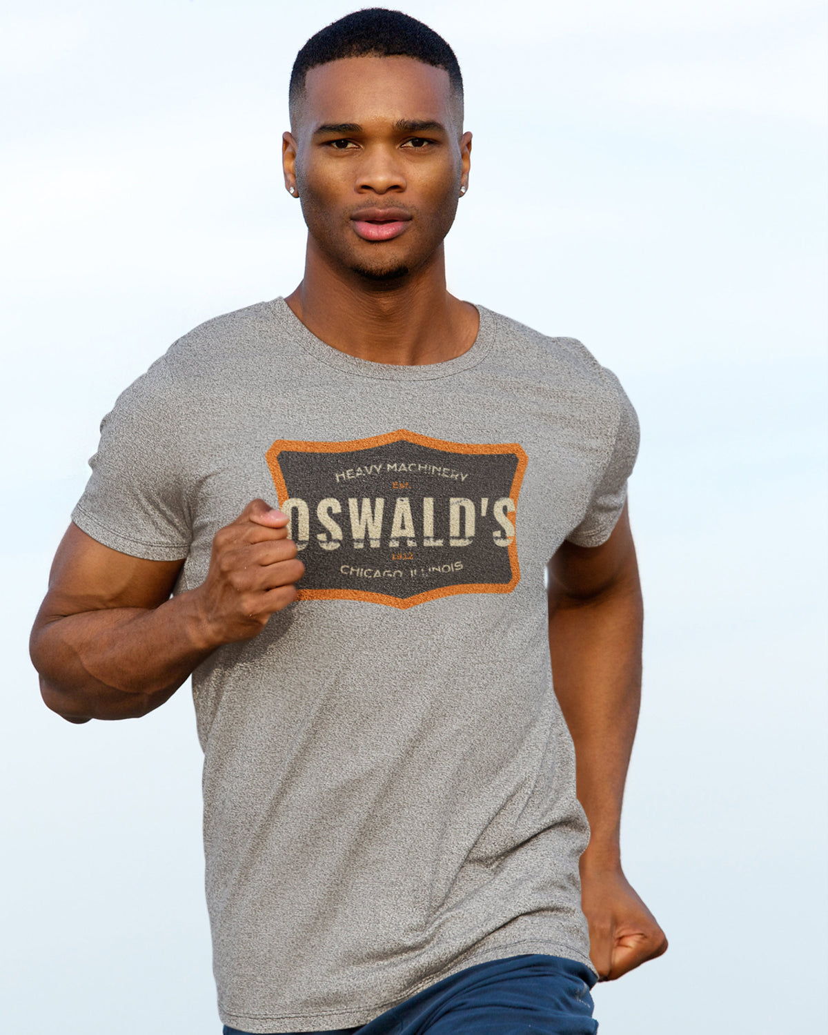Image of a Young Man Running Wearing a Custom Printed Heather Grey T-Shirt