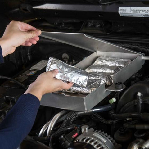 Ingenious Black Forest Jeep trail oven installs in engine cover mount