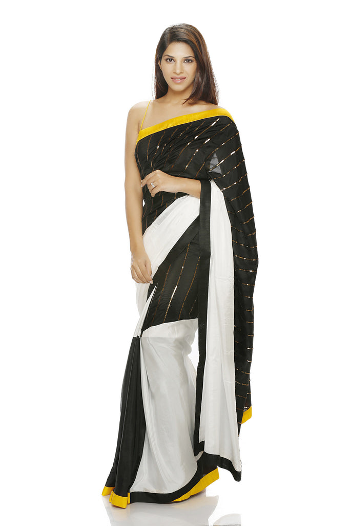 Black and white saree with embroidery and yellow border