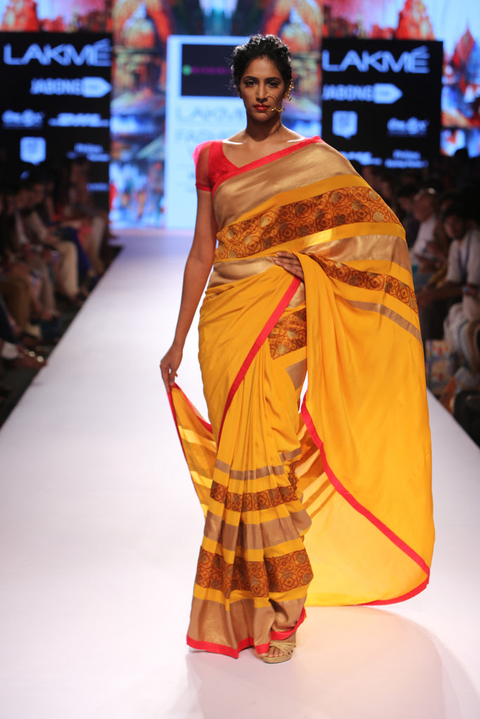 Mustard saree with brocade stripe