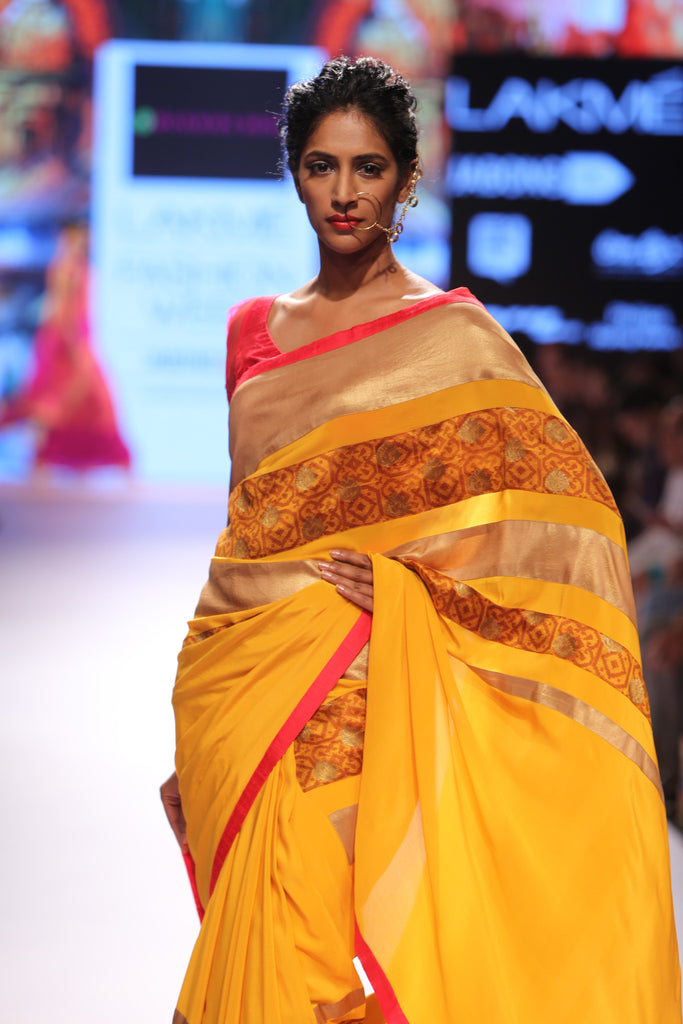 Mustard saree with borcade stripe