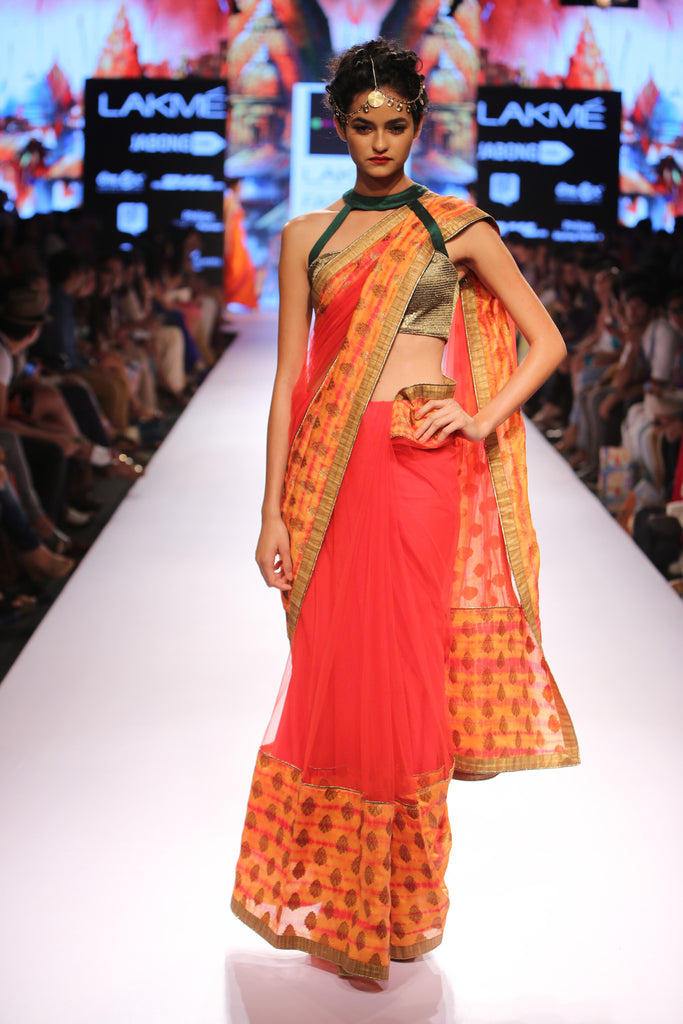 Red saree with a brocade border