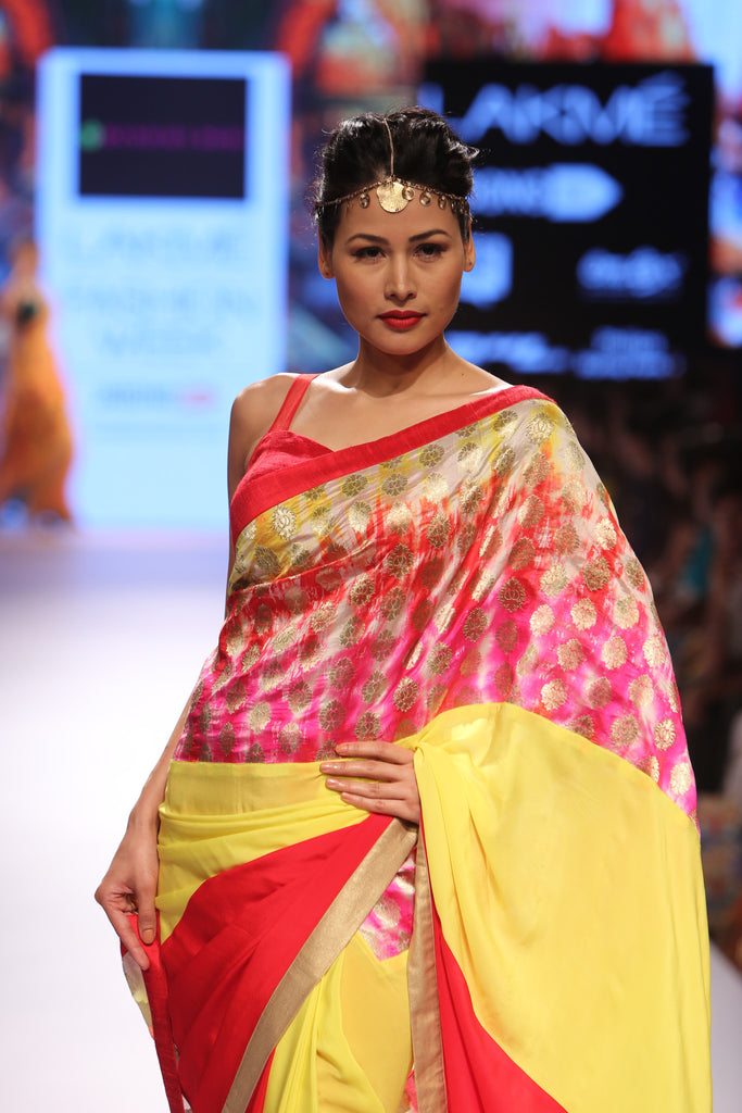 Red and yellow saree with multi colored brocade