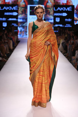 Orange tie and dye saree with embroidered motif