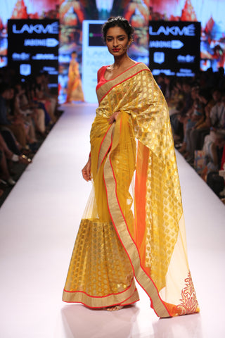 Yellow brocade saree with motif on the pallu