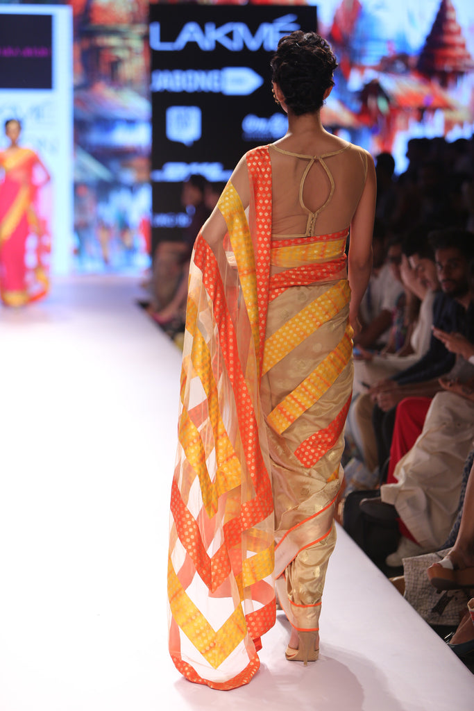 Beige saree with orange and yellow stripes