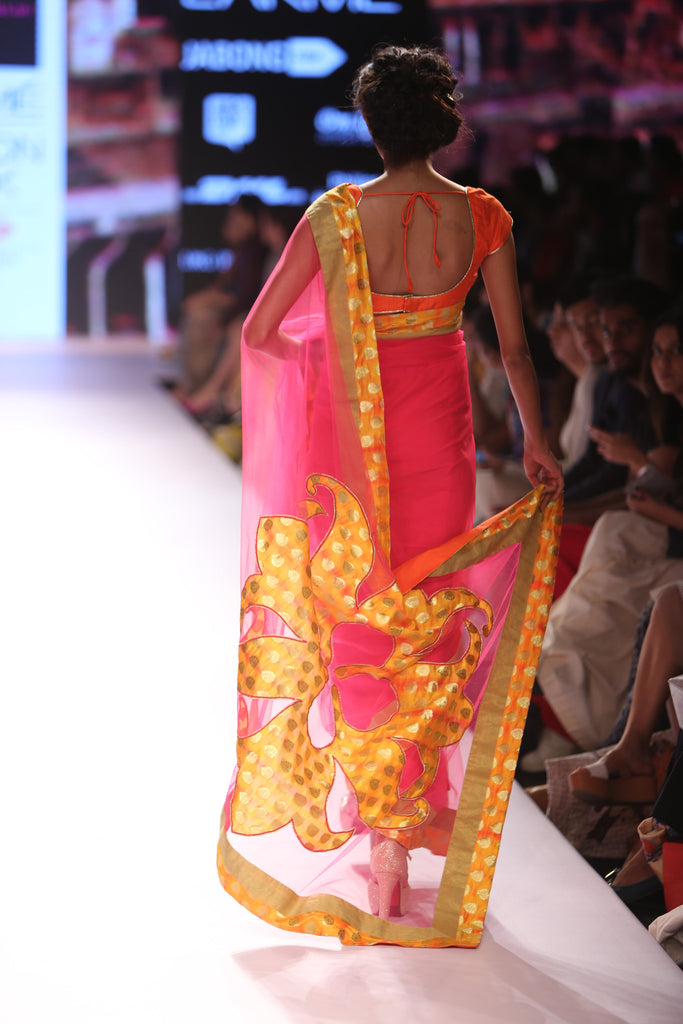 Pink saree with a logo on the pallu