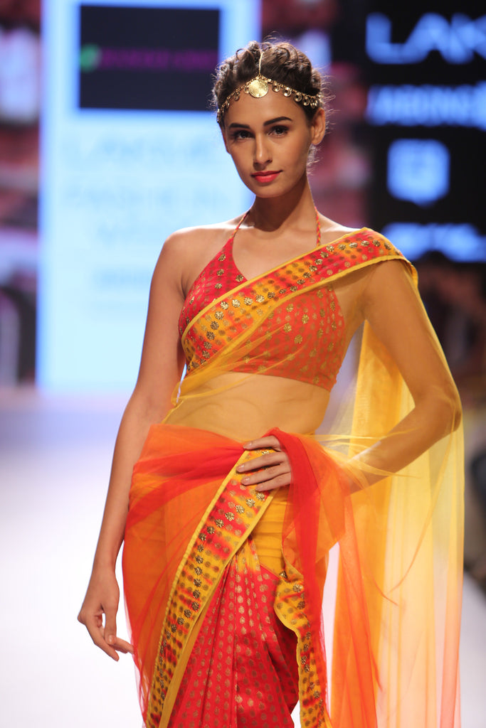 Yellow to orange shaded saree with hand embroidered border