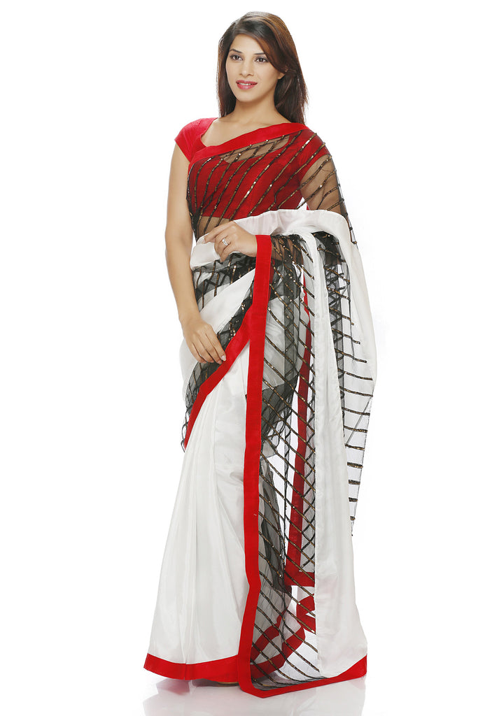 White Silk saree with hand embroidered panels
