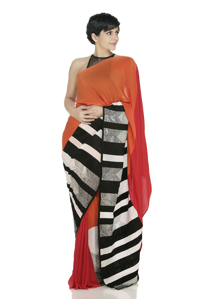 Orange red saree with sequin monochrome border