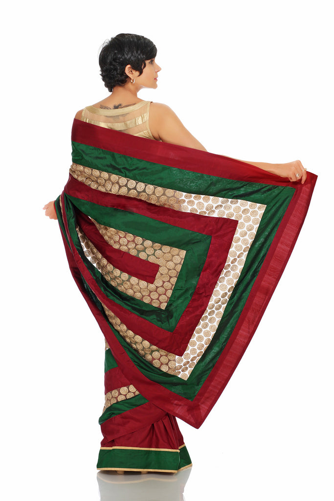 Maroon, green and gold striped saree