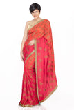 Orange shaded saree with hand embroidered motif and border