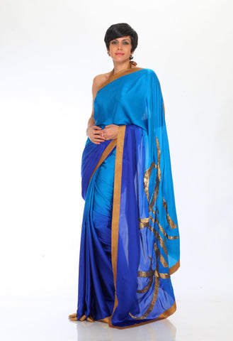 Blue Saree With Shanti Embroidered on Pallu.
