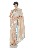 Beige saree with gold and and white Border
