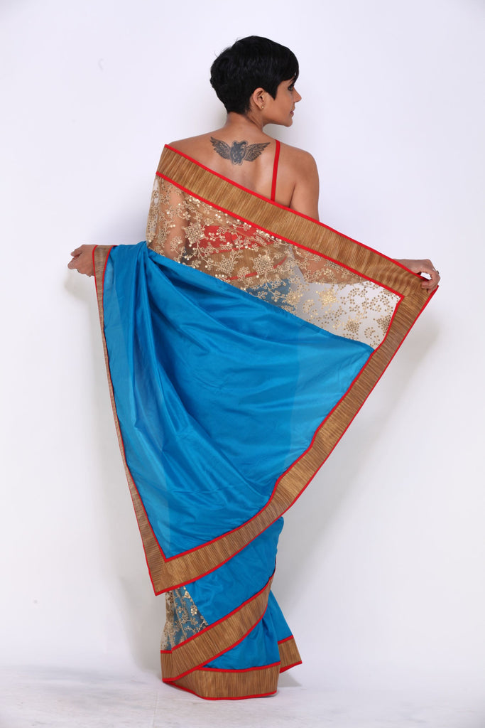 Turquoise Blue Saree with Geometric Net Panel