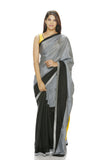 Grey and black saree with a geometric patch on pallu