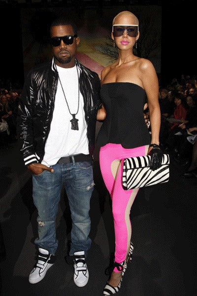 Kanye West wearing jesus piece while with Amber Rose