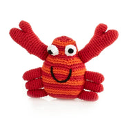 Smiling crochet red stripe crab baby rattle