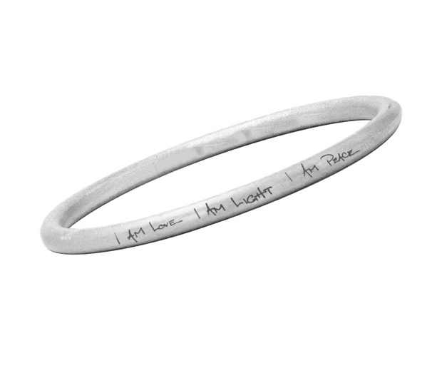 Love, light, peace bangle by Article22. Ethical jewelry available at Sophie Stargazer.