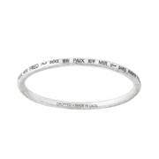 "metal bangle bracelet with ""peace"" written in many different languages"