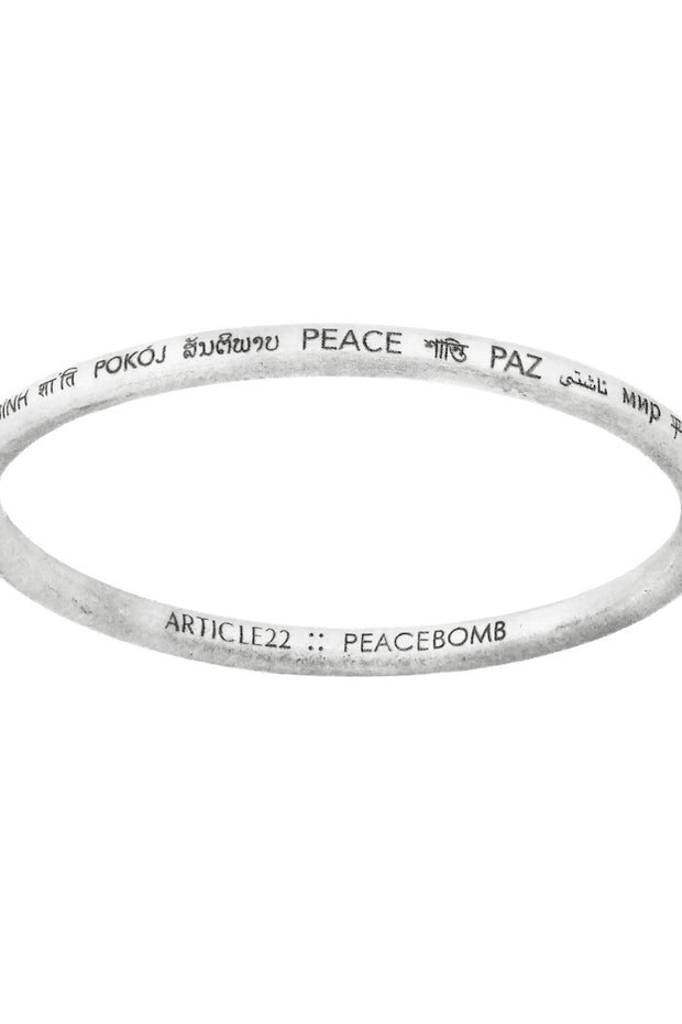Article22 peacebomb bangle bracelet. Ethical jewelry handmade in Laos.