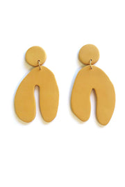 Mustard yellow colored wishbone polymer clay earrings by Sigfus. Shop the collection at Sophie Stargazer.