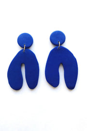Cobalt blue colored wishbone polymer clay earrings by Sigfus. Shop the collection at Sophie Stargazer.