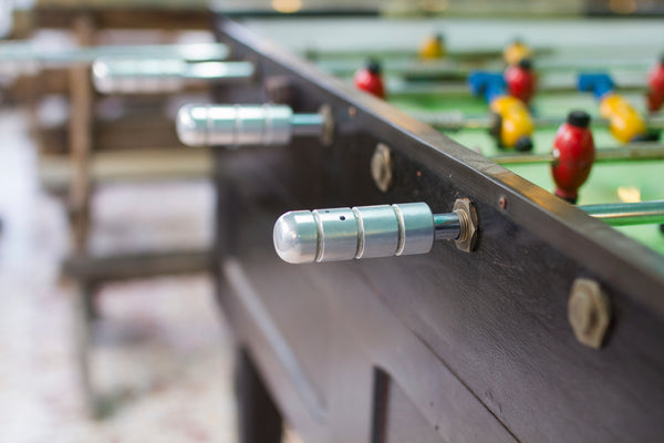A close-up of a popular outdoor foosball table.