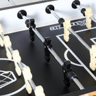 Players on a Atomic Pro Force Foosball Table by DMI Sports available at Foosball Planet.