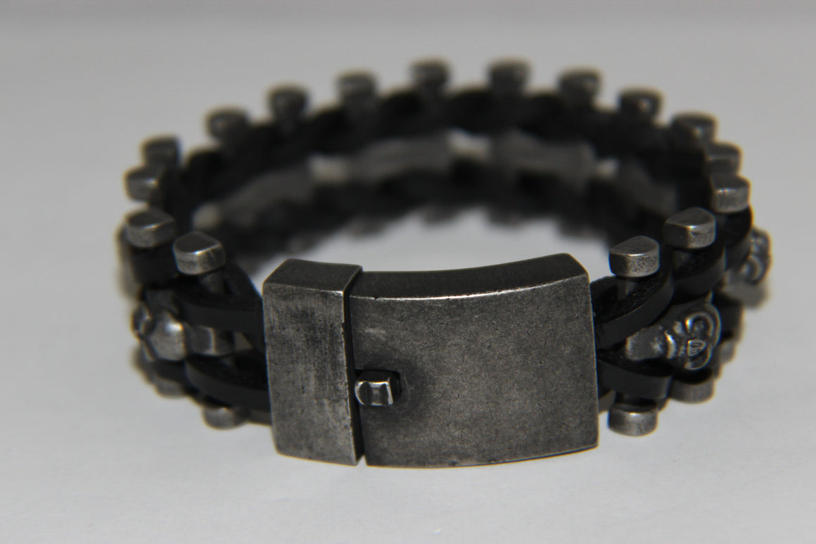 Stainless Steel Skull Links on Inside Weaved Leather Bracelet- UDINC0457