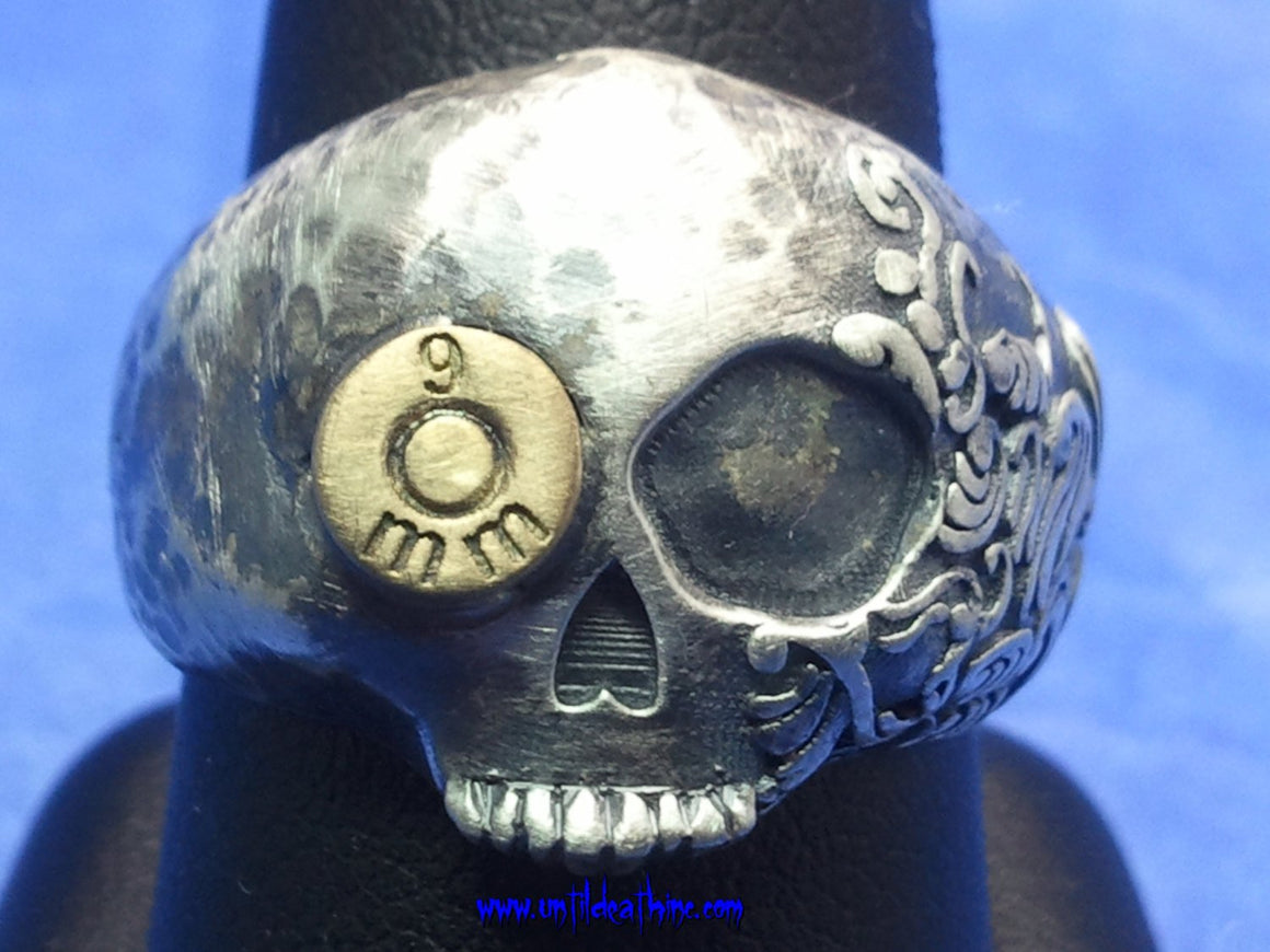 Hammered Fiji Skull Ring With Bullet in Eye in STERLING SILVER-UDINC0024