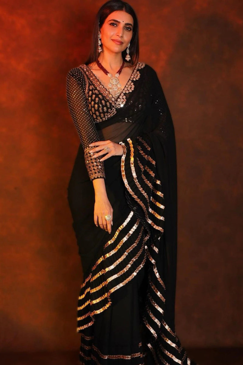 Black saree with mirror & gota patti embroidery. Paired with embroidered blouse.